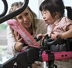 little girl using pink Rifton Pacer